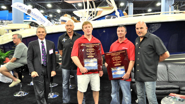 Chris Fertig and Tyson Gavin received an award from Boating Magazine for setting a new world record from New York to Bermuda aboard Fertig's diesel-powered 37' Statement center console. Shown here with Statement's Craig Barrie, Todd Werner, and Nick Buis.