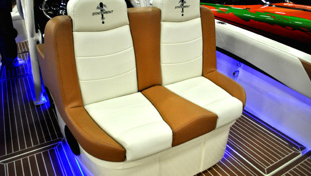 Standard helm seat on the 35 and 38 CC, features forward and aft-facing seating with integrated insulated storage.
