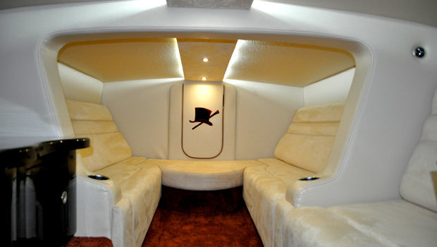 Comfortable facing love seats with a concealed marine head forward.