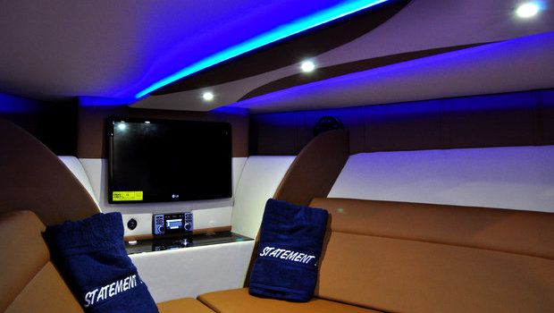 Roomy cabin on the 38' Statement center console. Shown here with available LED cabin mood lighting package.